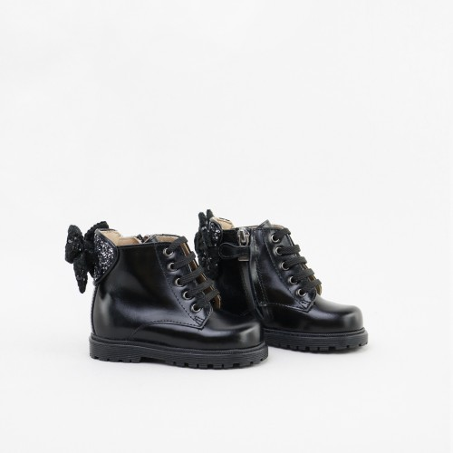Military boots with a bow